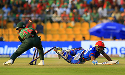 September 20, 2018 - Abu Dhabi, United Arab Emirates - Afghanistan cricketer Hashmatullah Shahidi dives in to complete a run as Bangladesh wicket keeper Liton Das removes the bails during the 6th cricket match of Asia Cup 2018 between Bangladesh and Afghanistan at the Sheikh Zayed Stadium,Abu Dhabi, United Arab Emirates on September 20, 2018. (Credit Image: © Tharaka Basnayaka/NurPhoto/ZUMA Press)