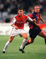 Tomas Danilevicius (Arsenal) and Emmanuel Petit (Barcelona). Arsenal v FC Barcelona, The Amsterdam Tournament, Amsterdam Arena, Holland, 3/8/2000. Credit Colorsport / Stuart MacFarlane.
