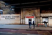 Underneath a railway bridge in Southwark, London, old signs for Blackfriars Station and The Charing CRoss Railway company can be found.