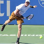 KYLE EDMUND hits a serve at the Rock Creek Tennis Center.