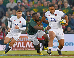 """Bloemfontein. Tendai """"The Beast"""" Mtawarira launches a fierce attack on his English opponent during the second trugby test between South Africa and England at Toyota Stadium in Bloemfontein. Photographer: Louis Botha/African News Agency (ANA)"""
