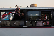 An anti-government demonstrator leaves Tahrir square by bus