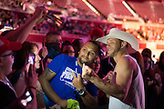 """DALLAS, TX - MARCH 13:  Donald """"Cowboy"""" Cerrone takes a photo with a fan during the UFC 185 weigh-ins at the Kay Bailey Hutchison Convention Center on March 13, 2015 in Dallas, Texas. (Photo by Cooper Neill/Zuffa LLC/Zuffa LLC via Getty Images) *** Local Caption *** Donald Cerrone"""