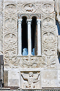 13th century reilief sculpture depicting the Kingdom of Good and salvation with Atlas at the bottom symbolically holding up the church which is represented at the top by the Lamb of God with 2 angels on either side and the four Fathers of the church in round panels running down either side of the central window, of the 8th century Romanesque Basilica church of St Peters, Tuscania, Lazio, Italy .<br /> <br /> Visit our ITALY PHOTO COLLECTION for more   photos of Italy to download or buy as prints https://funkystock.photoshelter.com/gallery-collection/2b-Pictures-Images-of-Italy-Photos-of-Italian-Historic-Landmark-Sites/C0000qxA2zGFjd_k .<br /> <br /> Visit our MEDIEVAL PHOTO COLLECTIONS for more   photos  to download or buy as prints https://funkystock.photoshelter.com/gallery-collection/Medieval-Middle-Ages-Historic-Places-Arcaeological-Sites-Pictures-Images-of/C0000B5ZA54_WD0s