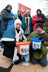 Staff at Virgin Media's Sheffield Office were sleeping rough out side their work place last night to raise awareness and funds for Shelter the Homeless charity. They were also collecting Blankets, Sleeping Bags and Clothes which will be donated to the local branch of Shelter..left to right; Danny Marshall, Louise Oxley, Will Helliwell, Laura Pattinson, Sarah Laidlores and Jono Clegg.10 November 2011. Image © Paul David Drabble