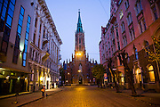 A church on a street at dawn in Old Town, Riga, Latvia.