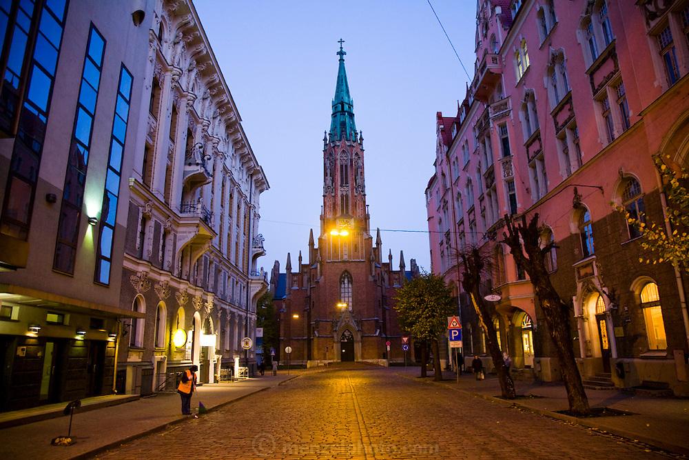 A church on a street at dawn in Old Town, Riga, Latvia.
