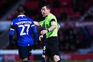 Peter Bankes (Referee) speaks to Gevaro Nepomuceno of Oldham Athletic (27) during the The FA Cup fourth round match between Doncaster Rovers and Oldham Athletic at the Keepmoat Stadium, Doncaster, England on 26 January 2019.
