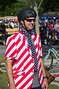 A man wearing a red, white and blue suit prepares to join the annual Sullivan's Island Independence Day parade July 4, 2017 in Sullivan's Island, South Carolina. The tiny affluent sea island hosts a bicycle and golf cart parade through the historic village.