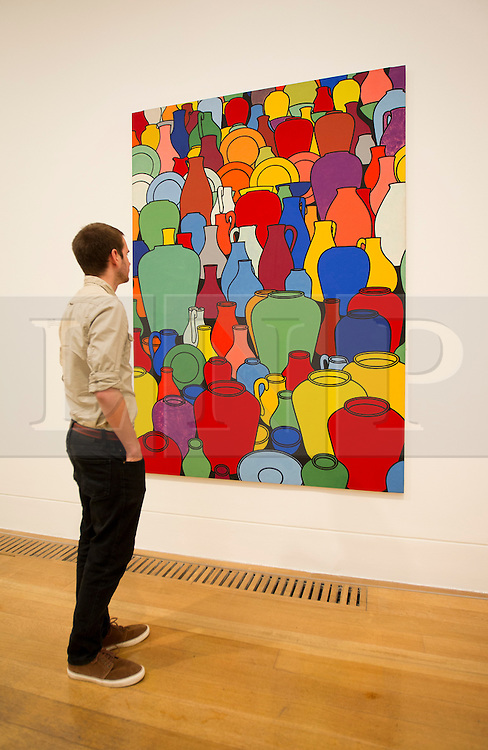 © Licensed to London News Pictures. 03/06/2013. London, UK. A Tate Britain employee views 'Pottery' (1975) an acrylic painting by British artist Patrick Caulfield at the press view for an exhibition of his work at the Tate Britain in London today (03/06/2013). The exhibition, running in tandem with an exhibition by British artist Gary Hume, is open to the public from 5th June - 1st September 2013 at the Tate Britain. Photo credit: Matt Cetti-Roberts/LNP