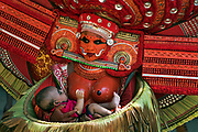 Theyyam (Teyyam, Theyam, Theyyattam) is a popular ritual form of dance worship in Kerala and Karnataka, India. Theyyam consisted of several thousand-year-old traditions, rituals and customs. The performers of Theyyam belong to the lower caste community in ancient caste structure formed by Namboothiri brahmins in Kerala, and have an important position in Theyyam. The people of these districts consider Theyyam itself as a channel to a God and they thus seek blessings from Theyyam.