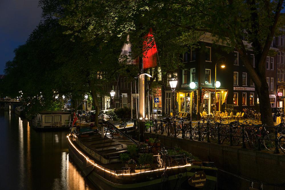 Canalside bar serving Heinekin beer in Prinsengracht, Amsterdam, Holland