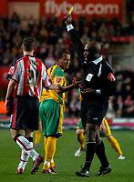 Photo: Alan Crowhurst.<br />Southampton v Norwich City. Coca Cola Championship. 16/12/2006. Referee Uriah Rennie shows Robert Earnshaw (C) a yellow card for diving.