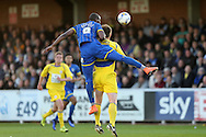 Tom Elliott of AFC Wimbledon jumps over Mark Hughes of Accrington Stanley to head the ball. Skybet football league two play off semi final, 1st leg match, AFC Wimbledon v Accrington Stanley at the Cherry Red Records Stadium in Kingston upon Thames, Surrey on Saturday 14th May 2016.<br /> pic by John Patrick Fletcher, Andrew Orchard sports photography.