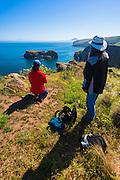 Hikers whale watching at Scorpion Cove, Santa Cruz Island, Channel Islands National Park, California USA