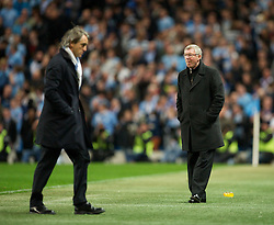 MANCHESTER, ENGLAND - Monday, April 30, 2012: Manchester United's manager Alex Ferguson and Manchester City's manager Roberto Mancini during the Premiership match at the City of Manchester Stadium. (Pic by David Rawcliffe/Propaganda)