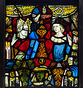 Fragments of 14th century stained glass thought to be from Dodnash Priory in Brantham church, Suffolk, England, UK