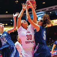 Shiprock Chieftain Tia Woods (30), center, and Silver City Fighting Colt Katelynn Limardo (25), left, and Larissa Bleich (5) reach for a rebound in a District 4A quarterfinal at The Pit in Albuquerque Tuesday.