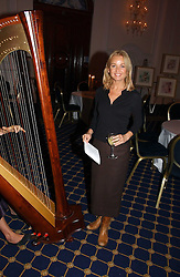 Actress LISA MAXWELL at a reception to launch Angel themed Christmas Cards and view an exhibition of the original art work by Gordon King with proceeds going to the Caron Keating Foundation  held at the Langham Hotel, Portland Place, London on 20th November 2006.<br />