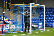 AFC Wimbledon groundsman checking the goal prior to kick off during the EFL Sky Bet League 1 match between AFC Wimbledon and Milton Keynes Dons at Plough Lane, London, United Kingdom on 30 January 2021.