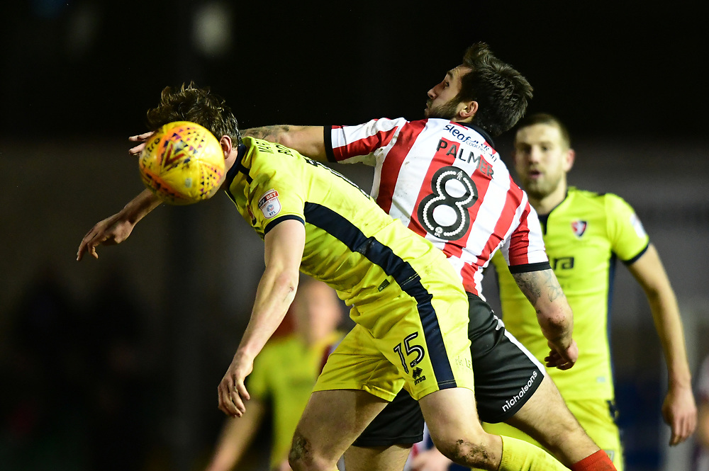 Lincoln City's Ollie Palmer vies for possession with Cheltenham Town's William Boyle<br /> <br /> Photographer Chris Vaughan/CameraSport<br /> <br /> The EFL Sky Bet League Two - Lincoln City v Cheltenham Town - Tuesday 13th February 2018 - Sincil Bank - Lincoln<br /> <br /> World Copyright © 2018 CameraSport. All rights reserved. 43 Linden Ave. Countesthorpe. Leicester. England. LE8 5PG - Tel: +44 (0) 116 277 4147 - admin@camerasport.com - www.camerasport.com