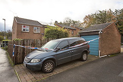 © Licensed to London News Pictures . 23/10/2014 . Penistone , UK . A car and garage , identified by a neighbour as belonging to the owner of the affected house . A fire in a house on Tennyson Close in Penistone near Barnsley has killed a nine year old boy and a 44 year old man and a boy aged 11 is critically ill in hospital . The house ( pictured with solar panels on the roof and smashed windows ) is cordoned off by police . Photo credit : Joel Goodman/LNP