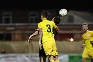 York City midfielder Sean Newton (3) beats Chester defender Simon Grand (3) in a headed dual during the Vanarama National League match between York City and Chester FC at Bootham Crescent, York, England on 13 November 2018.