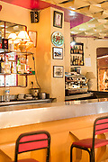 Interior detail of bar with coffee machine, lamp, shelf with bottles, Casablanca, Morocco