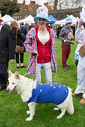 © Licensed to London News Pictures. 29/03/2017. London, UK. People dressed in Alice in Wonderland fancy dress play with a dog covered in an EU flag on College Green. British Prime Minister Theresa May has signed a letter to trigger Article 50 today. Photo credit : Tom Nicholson/LNP