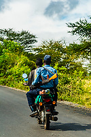 Policeman with AK47 assault rifle on the back of a motorcycle, Omo Valley,  Southern Nations Nationalities and People's Region, Ethiopia.