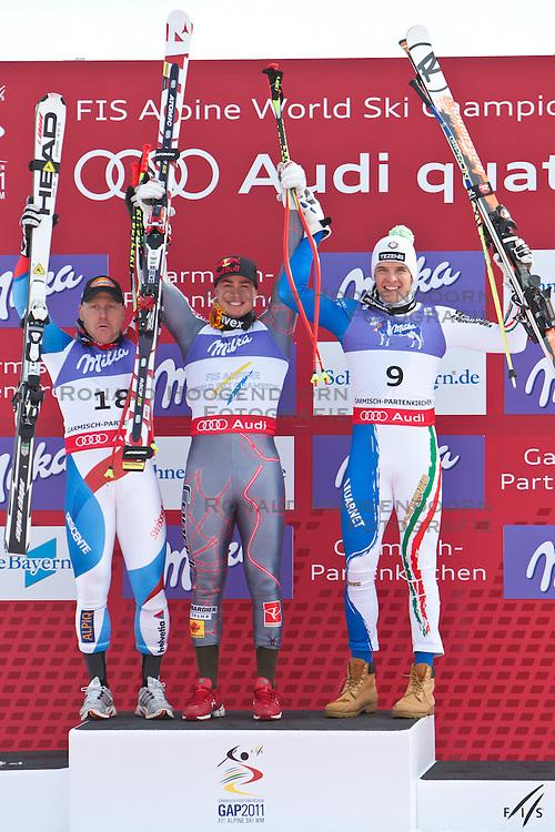 12-02-2011 SKIEN: FIS ALPINE WORLD CHAMPIONSSHIP: GARMISCH PARTENKIRCHEN<br />  silver Medal Didier Cuche (SUI), Gold Medal and World Champion Erik Guay (CAN) and bronze Medal Christof Innerhofer (ITA) during men's Downhill<br /> **NETHERLANDS ONLY**<br /> ©2011-WWW.FOTOHOOGENDOORN.NL/EXPA/ J. Groder