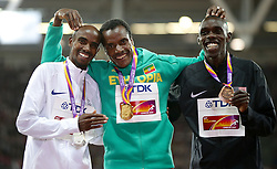 Ethiopia's Muktar Edris (centre) celebrates winning gold, Great Britain's Mo Farah with silver (left) and USA's Paul Kipkemoi Chelimo with Bronze after the Men's 5000m Final during day nine of the 2017 IAAF World Championships at the London Stadium. Picture date: Saturday August 12, 2017. See PA story ATHLETICS World. Photo credit should read: Yui Mok/PA Wire. RESTRICTIONS: Editorial use only. No transmission of sound or moving images and no video simulation.