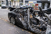 Burnt out Audi car in the city centre on 7th October 2020 in Birmingham, United Kingdom. In Birmingham, it is very common to see the wreckage of crashed, abandoned or burned cars as there is an abundance of car theft and wreckless driving, especially at night time when car racing is rife. Amongst local people the city has a reputation for wildness on the streets where a lack of policing results in a culture of lawlessness amongst some groups.