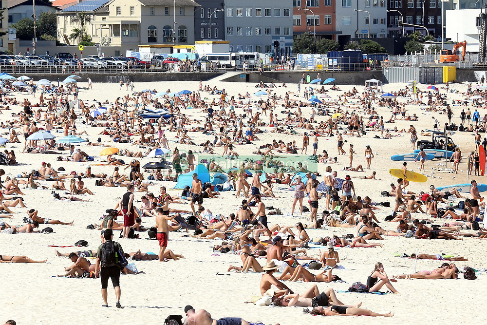AU_1902946 - *EXCLUSIVE* Bondi Beach, AUSTRALIA  - What Coronavirus... beach goers pack in like sardines at Bondi Beach. not a care in the world it seems. no mask, not social distancing.<br /> <br /> Pictured: Bondi Beach<br /> <br /> BACKGRID Australia 20 MARCH 2020 <br /> <br /> Phone: + 61 419 847 429<br /> Email:  sarah@backgrid.com.au