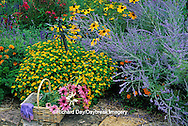 63821-08120 Cut bouquet in basket with gloves & dragonfly yard ornament in flower garden  Marion Co.  IL