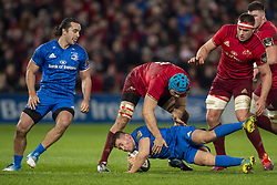 December 30, 2018 - Limerick, Ireland - Jordan Larmour of Leinster tackled by Tadhg Beirne of Munster during the Guinness PRO14 match between Munster Rugby and Leinster Rugby at Thomond Park in Limerick, Ireland on December 29, 2018  (Credit Image: © Andrew Surma/NurPhoto via ZUMA Press)