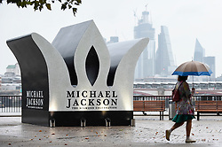© Licensed to London News Pictures. 29/08/2018. LONDON, UK.  Members of the public pass by a 13 foot high jewelled crown which has been installed on the South Bank to mark Michael Jackson's 60th birthday.  Photo credit: Stephen Chung/LNP