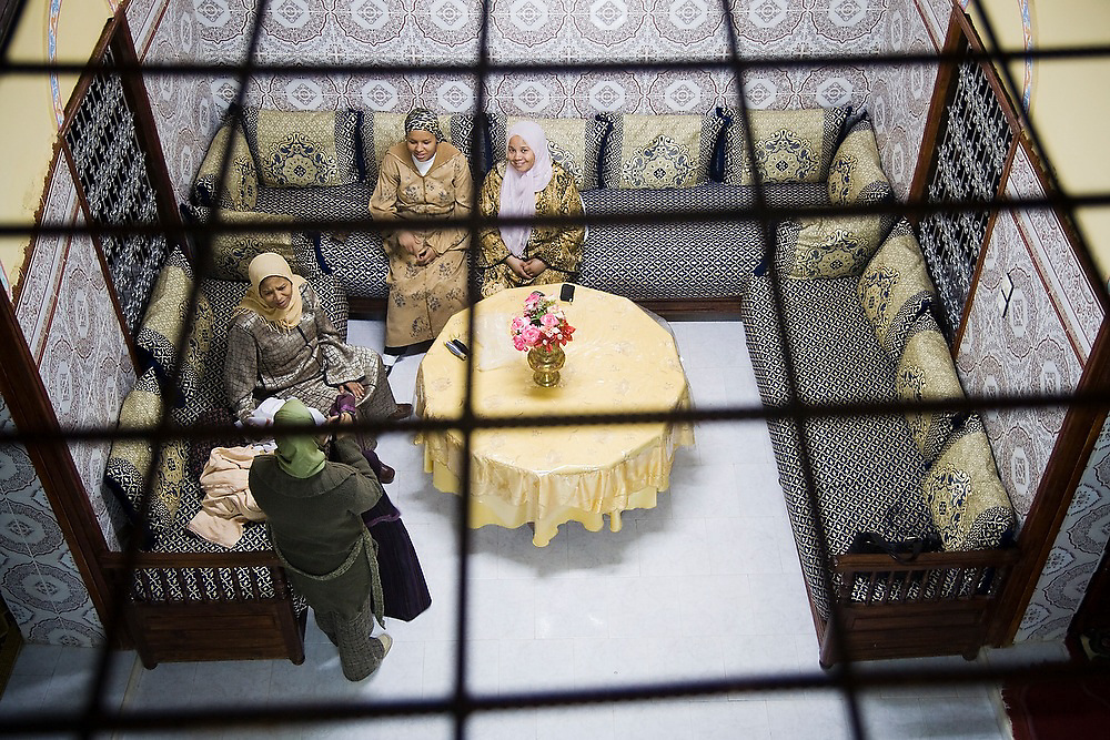 Moroccan women socialize in the living room of a traditional home in the Meknes medina, Morocco.