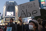"A woman holds a sign reading ""I am not Abe"" as people gather in silent vigil to honour hostages, Kenji Goto and Haruna Yukawa, who were murdered by ISIS terrorists in Syria in January. Shibuya, Tokyo, Japan Sunday February 8h 2015. Over 100 people gathered in Shibuya's famous Hachiko square at 5pm to hold a silent prayer vigil for the Japanese hostages and Jordan pilot. The vigil ended at 7:30pm with a small candle-lit shrine. Friends of the hostages were in the vigil and promised that all flowers and messages would be delivered to relatives."