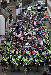 © under license to London News Pictures. 05/02/2011. Thousands of English Defence League members and supporters march through Luton Town Centre to demonstrate against Sharia Law. 2000 police are in the town to keep the peace.London News Pictures