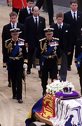 File photo dated 09/04/02 of the Prince of Wales (left) and the Duke of Edinburgh, followed by Princes William and Harry, leading the procession carrying the coffin of Queen Elizabeth, the Queen Mother, as they leave Westminster Hall, to make their way to Westminster Abbey for her funeral service. The Queen mother's funeral was the last royal funeral to be extensively televised in the UK. Issue date: Friday April 16, 2021.