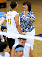 Heritage High coach Janet Hannigan talks to Freddy Moore before a match against Freedom High on Tuesday, May 8, 2012 at Heritage High School.  (Photo by Kevin Bartram)