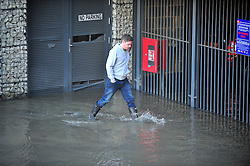 © Licensed to London News Pictures. 09/10/2016<br /> Townhall Square resident walking in flood water.<br /> Crayford town centre in Kent is closed and flooded this morning with hundred of homes across Dartford,Wilmington,Bexley,Crayford,Stone without water because of an over night issue with repairs by Thames Water at Crayford Road,Crayford.    Residents at Townhall Square have been flood with the under ground car park full of water. <br /> <br /> Photo credit :Grant Falvey/LNP