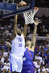November 27, 2017 - Quezon City, NCR, Philippines - Quincy Davis III (50) of Chinese Taipei tries to dunk the ball over Junemar Fajardo (15) of the Philippines..Gilas Pilipinas defeated the visiting Chinese Taipei team 90-83 to complete a sweep of their first two assignments in the FIBA 2019 World Cup qualifiers. (Credit Image: © Dennis Jerome S. Acosta/Pacific Press via ZUMA Wire)