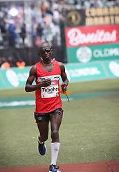 10062018 (Durban) A 7th position Teboho Sello, Lesotho (5:42:21) run towards the finnish line during the 2018 Comrades marathon in Durban.<br /> Picture: Motshwari Mofokeng/ANA