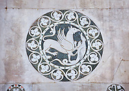 Late medieval inlay sculpture depicting a Griffin killing a mythical animal on the Facade of the Cattedrale di San Martino,  Duomo of Lucca, Tunscany, Italy, .<br /> <br /> Visit our ITALY HISTORIC PLACES PHOTO COLLECTION for more   photos of Italy to download or buy as prints https://funkystock.photoshelter.com/gallery-collection/2b-Pictures-Images-of-Italy-Photos-of-Italian-Historic-Landmark-Sites/C0000qxA2zGFjd_k<br /> <br /> <br /> Visit our MEDIEVAL PHOTO COLLECTIONS for more   photos  to download or buy as prints https://funkystock.photoshelter.com/gallery-collection/Medieval-Middle-Ages-Historic-Places-Arcaeological-Sites-Pictures-Images-of/C0000B5ZA54_WD0s .<br /> <br /> If you prefer to buy from our ALAMY PHOTO LIBRARY  Collection visit : https://www.alamy.com/portfolio/paul-williams-funkystock/lucca.html .