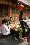Teenagers playing cards in Ping An, Guilin, China