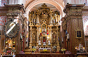 Cathedral interior with ornate altar, Quito, Ecuador.