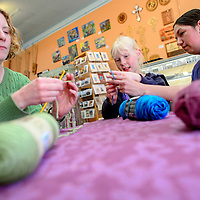 051414       Cable Hoover<br /> <br /> Instructor Brandy Lee, right, shows Leslie Norton and Heidi Norton how to start a crochet chain during a class at Makeshift Gallery in downtown Gallup Wednesday.