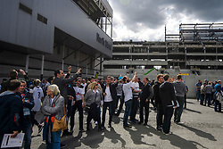 © Licensed to London News Pictures. 14/05/2017. London, UK. Fans gather to take pictures of the new stadium which is being built next to White Heart Lane, in North London where Tottenham Hotspur F.C. are playing their final game at the ground, against Manchester united today (Sun). Known as 'The Lane', Tottenham have been playing at the ground for 118 years, but will be playing at Wembley next season while a new 60,000 seat stadium is built for the start of the 2018/19 season.  Photo credit: Ben Cawthra/LNP